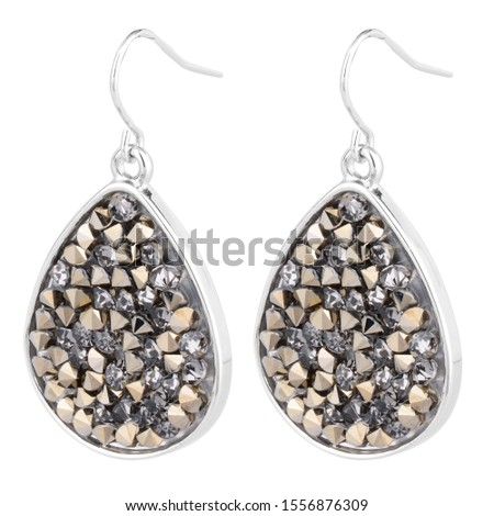 Silver earrings embedded with stones on white background