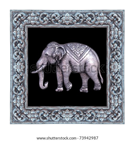 Silver elephant and silver frame handmade in a Thai temple.