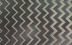 Silver fabric. Symmetrical zigzag lines. Modern pattern. Original background, wallpaper.