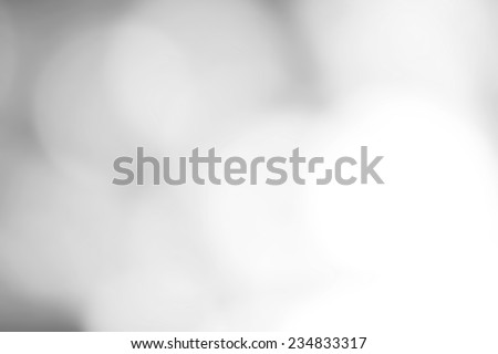 Silver Festive Christmas background. Abstract twinkled bright background with natural bokeh defocused white lights. Holiday party background with blurry special magic effect.