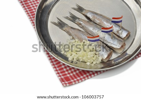 Silver Fish on Silver Plate with chopped onions and Dutch flags