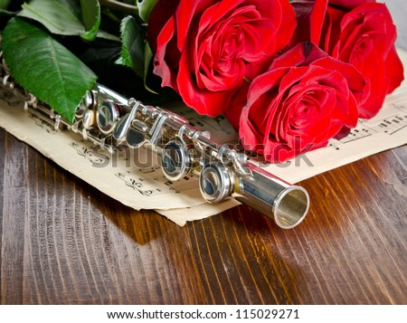 Silver flute, notes and roses. Musical background.