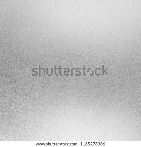Silver foil background texture and White shiny shimmer metal wall, with glitter and sparkle for christmas paper card and paillette glow or glamour gray color, Abstract bright light or sequin material.