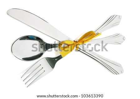 Silver fork and spoon, knife tied with a yellow ribbon isolated on white - stock photo