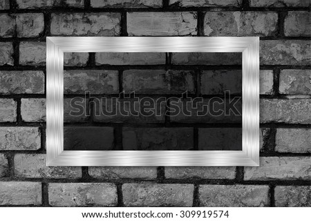 silver frame on the Old grunge brick wall. text box. art