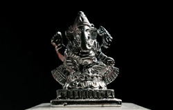 Silver Ganapathi / Ganesha Idol decorated with flowers for Ganesh Chaturthi