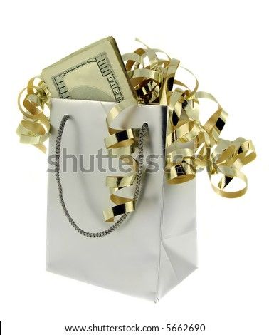 Silver gift bag and money with gold ribbons against a white background.