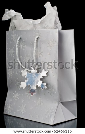 Silver gift bag on a black background - stock photo