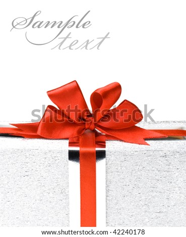 Silver gift boxes with red ribbons