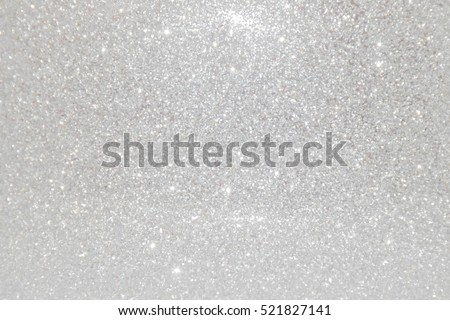 Silver giltter abstract bokeh background Christmas.