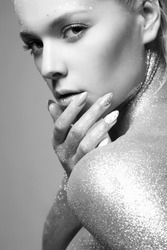 Silver Girl. Beautiful Woman with Sparkles on her Face and Body. Fashion Monochrome Portrait