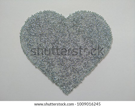 silver glass beads on heart shaped - Shutterstock ID 1009016245