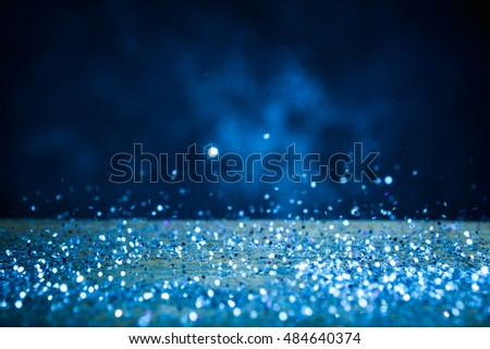 Silver Glitter Lights Background. Vintage Sparkle Bokeh With Selective Focus. Defocused. On Wood Texture. Cool Blue Filtered Color.