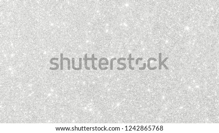 Silver glitter texture white sparkling shiny wrapping paper background for Christmas holiday seasonal wallpaper decoration, greeting and wedding invitation card design element
