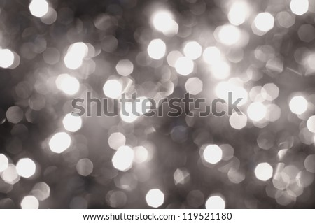 Silver glitters blurred background