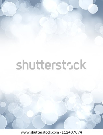 Silver glitters on a soft blurred background with smooth highlights