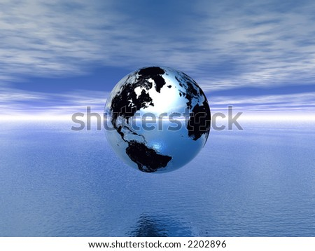 silver globe, blue sky and ocean
