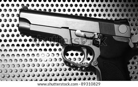 silver gun  on metal background