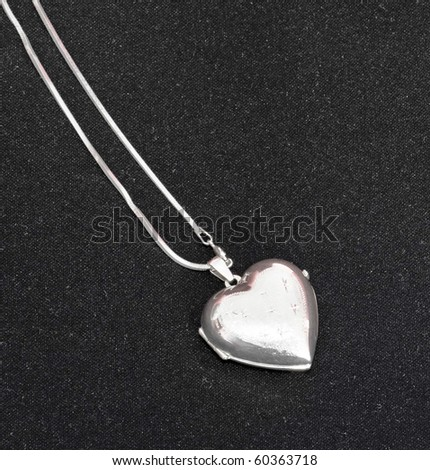 Silver heart closed - jewelery on black background