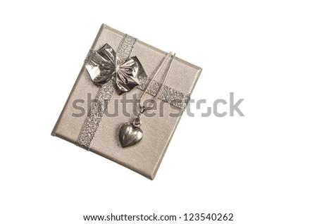 Silver heart on a beautiful silver box