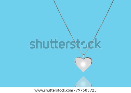 Silver heart on pastel background #797583925