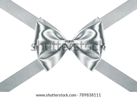 silver holiday gift bow with crosswise ribbons on white background #789838111