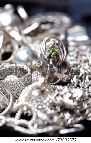 Silver jewlery on black background - stock photo