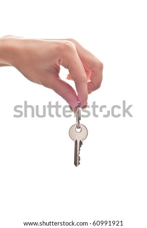 Silver key in woman's hand. Isolated on white
