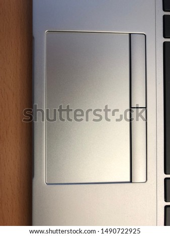 Silver laptop touch pad with two buttons #1490722925