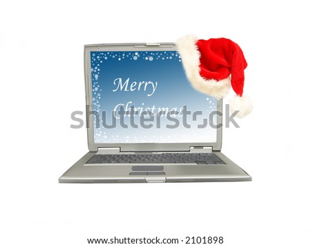 Silver laptop with Merry Christmas greetings display with red santa claus hat put on lcd corner - stock photo