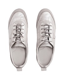 Silver leather sneakers white background isolated close up top view, stylish light gray suede gumshoes, pair of beige shoes with laces, two chamois casual boots, fashion sport urban walking footwear