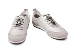 Silver leather sneakers white background isolated closeup front and side view, light gray suede gumshoes, pair of beige shoes with laces, two chamois casual boots, fashion sport urban walking footwear
