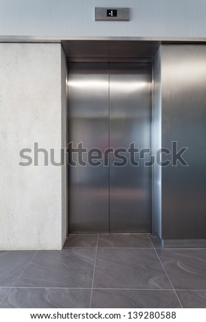 Silver lift door in a business centre