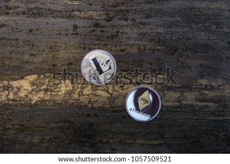 silver litecoin and ethereum on dark bronze background #1057509521