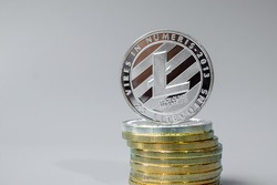 Silver Litecoin (LTC) cryptocurrency coin stack, Crypto is Digital Money within the blockchain network, is exchanged using technology and online internet exchange. Financial concept