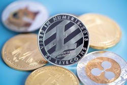 Silver Litecoin LTC group included with Cryptocurrency coin Dogecoin DOGE, bitcoin BTC, Binance Coin, Zcash TRON symbol Virtual blockchain technology e-banking is money close-up and Macro concept.