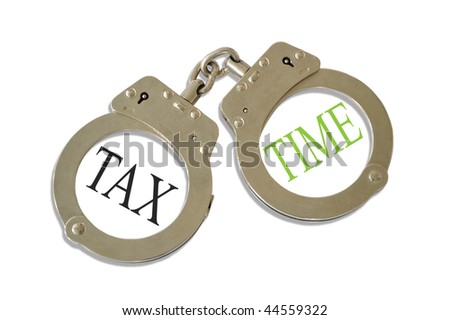 Silver metal handcuffs tax time concept