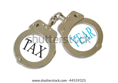 Silver metal handcuffs tax year concept