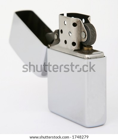 Silver metal zippo lighter for cigarettes, close up, macro, copy space, isolated on white