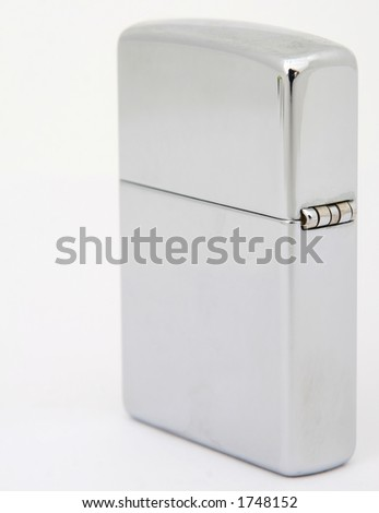 Silver metal zippo lighter for cigars close up, macro, copy space, isolated on white
