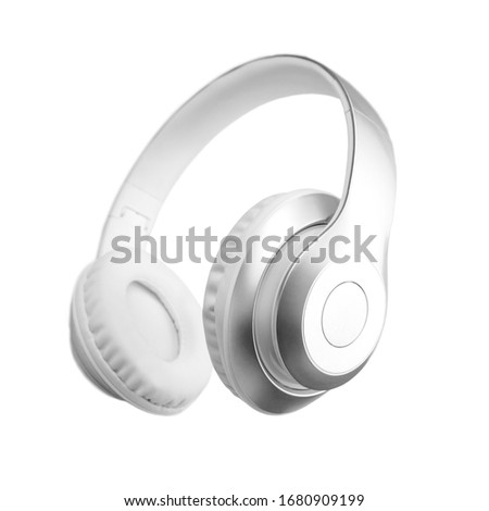 Silver metallic white wireless headphones in the air isolated on white background. Trendy minimal music device flying levitation concept of accessories. New technologies. Closeup high resolution Foto stock ©