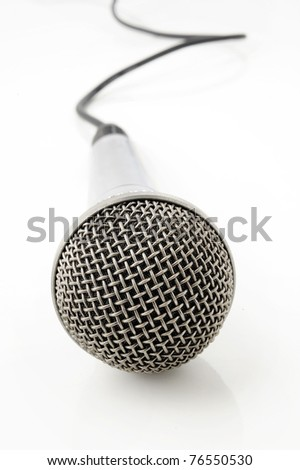 Silver microphone with black wire on white