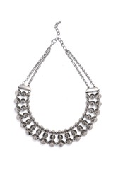 silver necklace studded on a white background