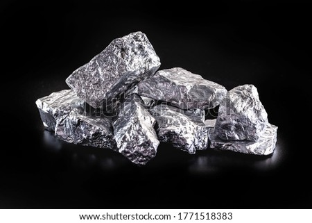 silver nugget native to Liberia isolated on black background. Rare stone for industrial extraction ore Foto d'archivio ©