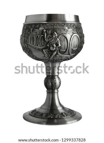 Silver or pewter wine goblet bas-relief and Latin inscription - In Vino Veritas. Photo with a shallow depth of field  #1299337828
