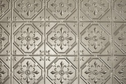 Silver or tin pressed metal wall or ceiling panelling. Retro, vintage wall or ceiling panelling.