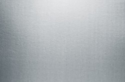 Silver paper texture background. Gray metallic paper sheet surface. Shiny cardboard with smooth gradient reflection