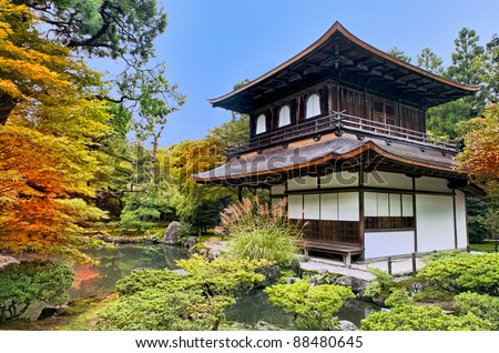 Silver Pavilion Ginkakuji in Japanese Zen garden in Kyoto in fall surrounded by trees with red, yellow and orange foliage