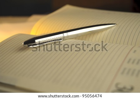 silver pen on notebook