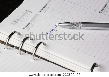 silver pen on open business agenda